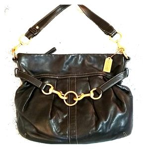 Stylish Black Coach Shoulder Bag with Gold Accents
